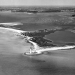 DP New Point Comfort lighthouse  56 - New Point Comfort lighthouse from the air. The Mathews County mainland is seen in the background. Watermen say the island shifts from one pattern to another as storms eat into the shoreline. Oct 1956. Daily Press archive   No Mags, No Sales, No Internet, No TV